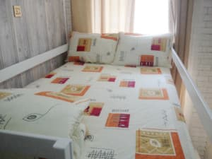 Hotels . Hotel Double bed in multiple bedded mixed room.