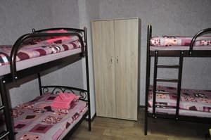 Hotels . Hotel Bed in multiple bedded female dormitory room.