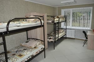 Hotels . Hotel Bed in multiple bedded male dormitory room.