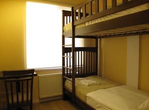 Hotels . Hotel Double comfort room with bunk bed.