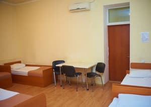 Hotels . Hotel Multiple bedded female dormitory room with facilities.