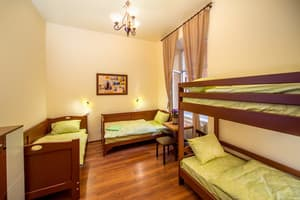 Hotels . Hotel 4-bedded mixed dormitory room with bathroom.