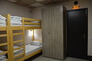 Hotels . Hotel 8-bedded male dormitory room.