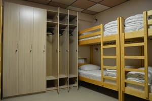 Hotels . Hotel 8-bedded female dormitory room.