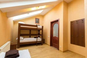 Hotels . Hotel Multiple bedded room with shared bathroom.