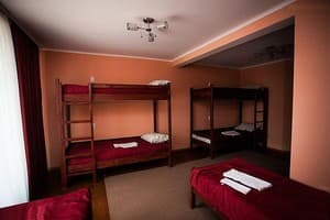 Hotels . Hotel Bed in 6-bedded mixed dormitory room.